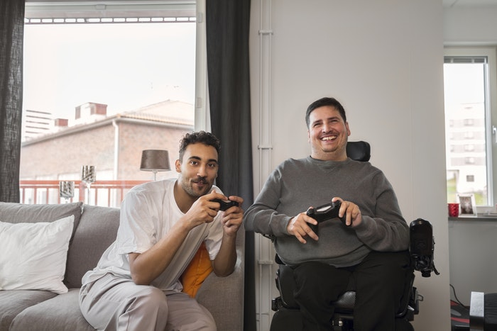 two-young-men-playing-video-games-jpg