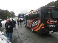 Local tour  bus handles bad weather