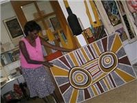 Tiwi artist Nina with one of her ceremonial works