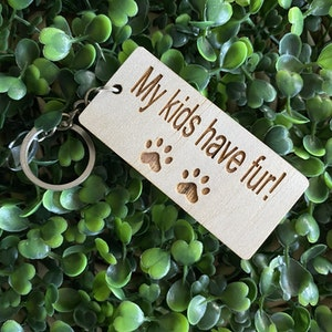 """""""My kids have fur!"""" Quirky Timber Keyring - Laser Cut & Etched on Timber with Silvertone Hardware finished with a LLL Logo Tag."""