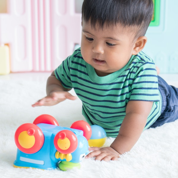 Image of a baby boy playing with toys
