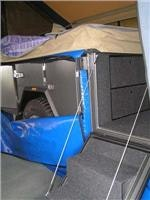 Fold-down stairs lead to Complete Campers  bed