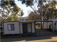 Budget caravan park cabin accommodation costs compare well with towing caravans to powered sites