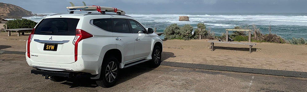 white-4wd-parked-at-the-beach-jpg