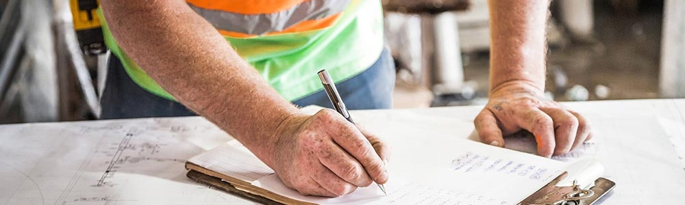 adult-in-high-vis-with-pen-to-clipboard-pn-counter-jpg