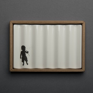 Soap Dish with Child Blowing a Dandelion